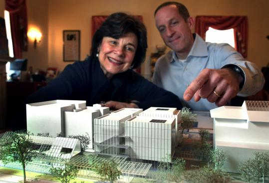 Director Anne Hawley and director of operations Jim Labeck with a model of the wing (center) now under construction at the Isabella Stewart Gardner Museum. The structure &#8220;relieves a lot of stress on the historic building,&#8217;&#8217; Labeck said.
