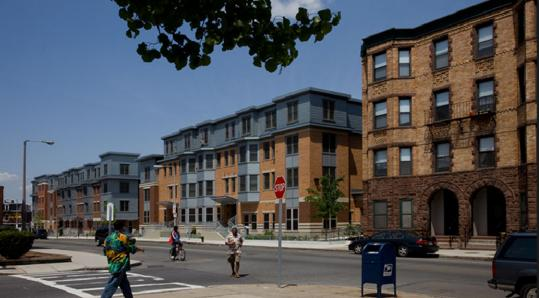 Dudley Village in Roxbury, 50 apartments in five buildings, is the latest achievement of the Boston firm The Narrow Gate.