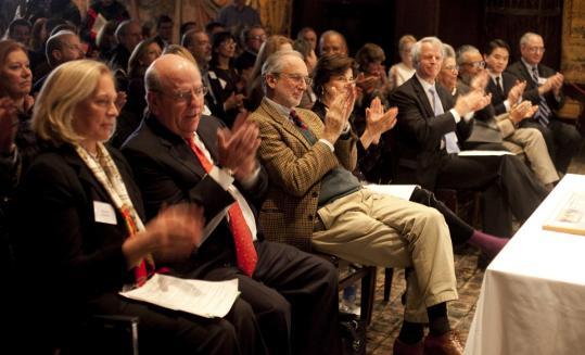 Architect Renzo Piano (center) applauds at a presentation of his final design for the Gardner Museum extension.