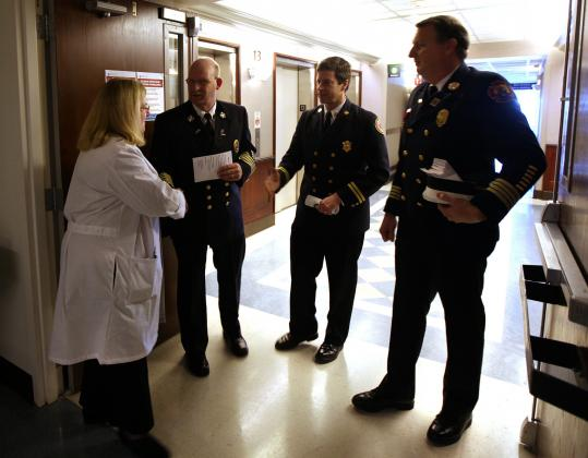 Dr. Colleen Ryan ended a tour of the Massachusetts General Hospital burn unit for fire officials: from left, Chief Paul Zbikowski of the Fire Chiefs Association of Massachusetts Inc.; Kevin P. Partridge of the state Department of Fire Services; and Deputy Chief Michael A. Young of the Plymouth Fire Department and the Fire Prevention Association of Massachusetts.