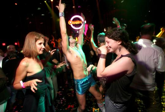 From left, audience members Tali Faber and Naomi Choodnovskiy danced with one of the performers at 'The Donkey Show.'
