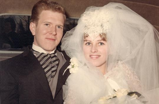 The bride and groom on their wedding day in 1968, in a photograph that hangs at their house on a staircase wall.