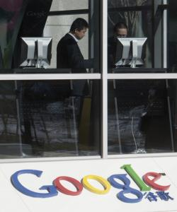 A Google office was active in Beijing yesterday. The search engine praised Hillary Rodham Clinton's critical comments.