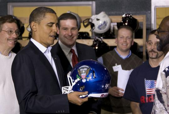 At the Riddell sports equipment plant in recession-weary Elyria, Ohio, President Obama yesterday received a football helmet adorned with the presidential seal and the number 44.