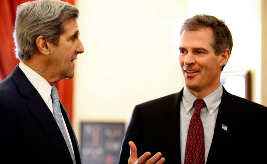 Scott Brown's visit to Washington, where he will be John Kerry's Senate colleague, coincided with a bipartisan effort by Kerry and other senators to revive global warming legislation.
