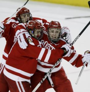 BU's Colby Cohen (right) celebrates with teammates after scoring in overtime.
