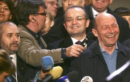 Aliodor Manolea (left, with beard), a parapsychologist, was seen next to Romania's President Traian Basescu (right) at an event last month. Manolea's specialties include deep mind control.