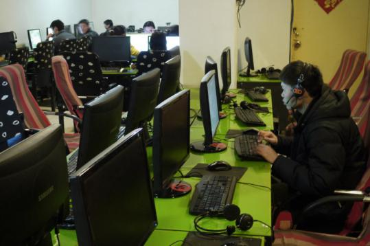 People surfed online at an Internet cafe in Dunhuang, in China's Gansu province, last week. Chinese officials have blocked Internet access in Xinjiang for about six months.