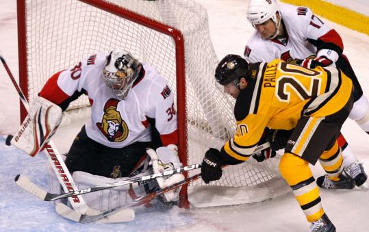 The Bruins' lack of scoring touch again was a problem; here Daniel Paille is denied on a wraparound by Ottawa's Brian Elliott.