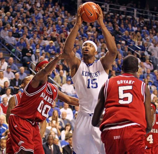 Kentucky's DeMarcus Cousins (16 points, 14 rebounds) squeezes between a pair of defenders.