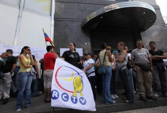 Employees of the Radio Caracas Television stood outside of the channel offices in Caracas yesterday.