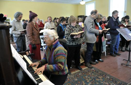 Penny Schultz, musical director at West Cummington Congregational, played yesterday at the Parish House.