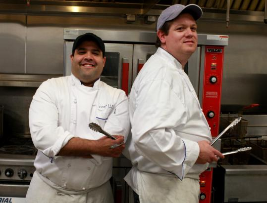 Chefs Dennis Tourse (left) and Jamie Rogers of Forklift Catering will prepare special menus for their customers' upcoming Super Bowl parties.