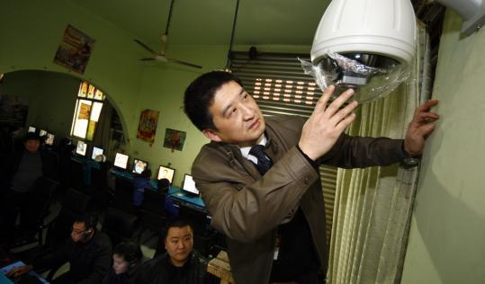 A cultural inspection official installed a surveillance camera in an Internet cafe in Suining in China's Sichuan province.