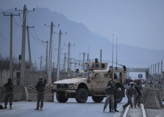 Soldiers secured the site of an attack yesterday after a suicide bomber detonated a van full of explosives near a US base.