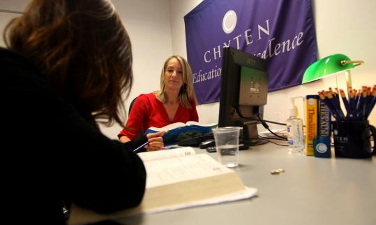 Emily Snodgrass tutors students at Chyten Educational Services in Lexington. The tutoring business is thriving in a tough economic setting, and Chyten has over two dozen locations, including in Pittsburgh and Lake Oswego, Ore.