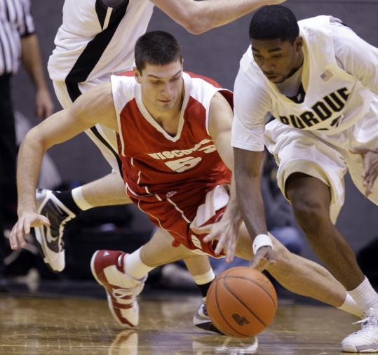 E'Twaun Moore steals the ball from Wisconsin's Keaton Nankivil in the second half of Purdue's victory. Nankivil scored 25 points in a losing cause.
