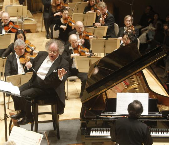"Conductor James Levine and pianist Pierre Laurent Aimard starred in last night's clear, exacting performance of Elliott Carter's ""Dialogues.''"