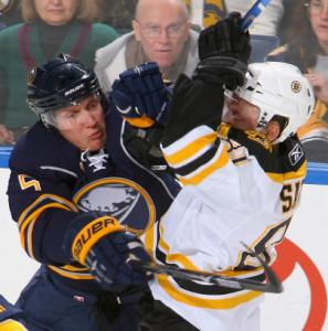 The Sabres' Toni Lydman has a run-in with the Bruins' Miroslav Satan in the first period.