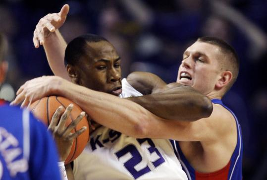 Kansas big man Cole Aldrich has Kansas State's Dominique Sutton surrounded.