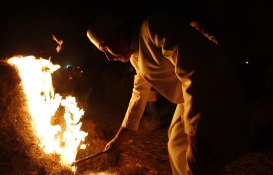 An Iranian Zoroastrian priest ignited a blaze during the annual Sadeh, an ancient Persian festival marking the creation of fire.