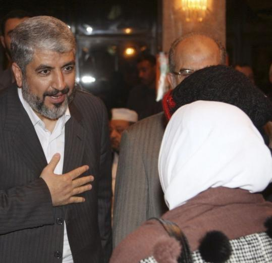 Hamas leader Khaled Meshaal accepted condolences during the funeral for commander Mahmoud al-Mabhouh yesterday.