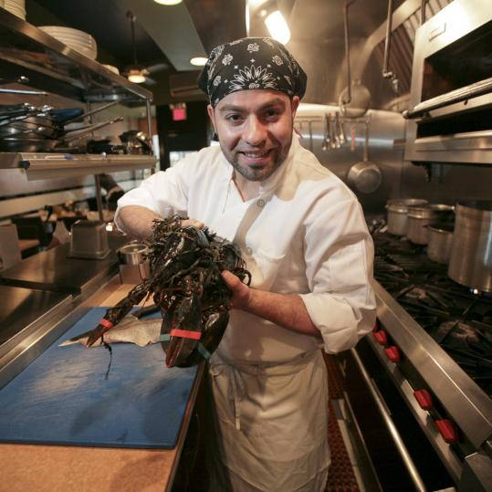 """Every day is different. I don't just cook. I catch the fish, I cut the fish, I clean the fish,'' says Daily Catch chef Basil Freddura, pictured at the restaurant's Brookline location."
