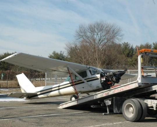 The Cessna 152 was loaded onto a flatbed truck after it was removed from the roadway. Traffic was backed up about 1 1/2 miles in each direction after the pilot landed the plane.