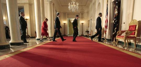 President Obama (right) at the White House yesterday. Trailing him, from left, were chief economic adviser Lawrence Summers; Christina Romer, Council of Economic Council chair; budget director Peter Orszag; and Treasury Secretary Timothy Geithner.