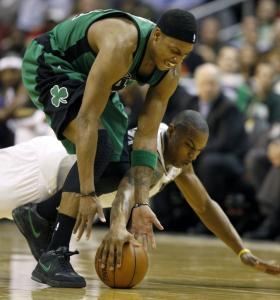 A diving Caron Butler gets a piece of the ball and a piece of Paul Pierce's left ankle during a collision in the first half.