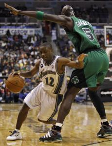 Fearless 5-foot-5-inch Wizard Earl Boykins takes his dribble right into the heart of the Celtics' defense, scampering around 6-11 Kevin Garnett in the second half.