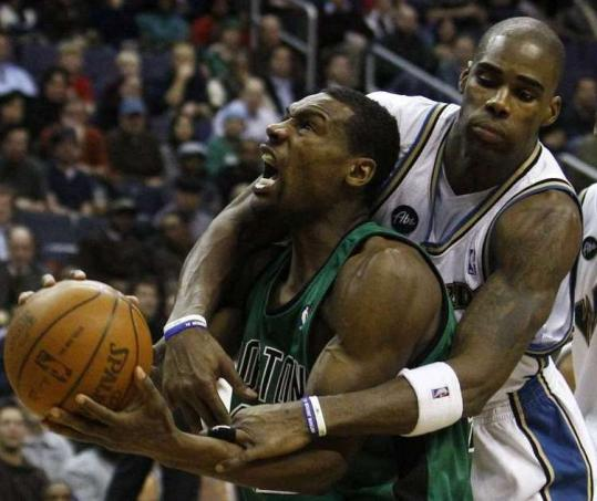 The Wizards' Antawn Jamison's hands-on defense prevented Tony Allen from going to the basket in the fourth quarter.