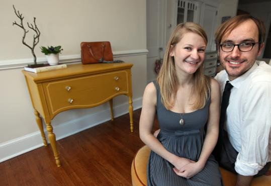 Lauren Zimmerman and Nick Siemaska in front of a bureau they refurbished.