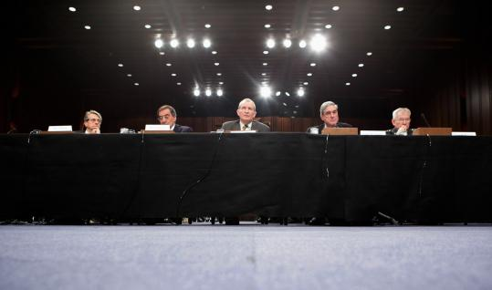 Intelligence officials (from left), John Dinger, Leon Panetta, Dennis Blair, Robert S. Mueller, and Ronald Burgess testified before the Senate Intelligence Committee yesterday on Capitol Hill, saying Al Qaeda operatives are being deployed to the United States.