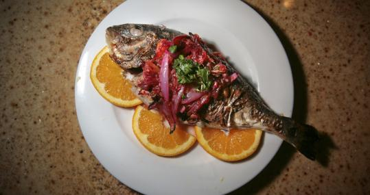 "A dish of fish with segments of orange and lemon drew inspiration from Luis Mel�ndez's ""Still Life With Bream, Oranges, Garlic, Condiments and Kitchen Utensils'' (lower left)."
