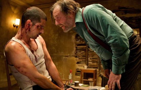 "Gangster Colin (Ray Winstone) confronts the hostage (Melvil Poupaud) in ""44 Inch Chest.''"