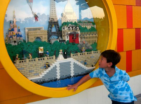 A LEGO lover is enthralled by a Downtown Disney display.