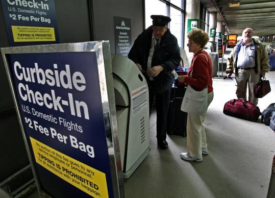 Skycaps say tipping fell after American Airlines started charging $2 a bag for curbside check-in.