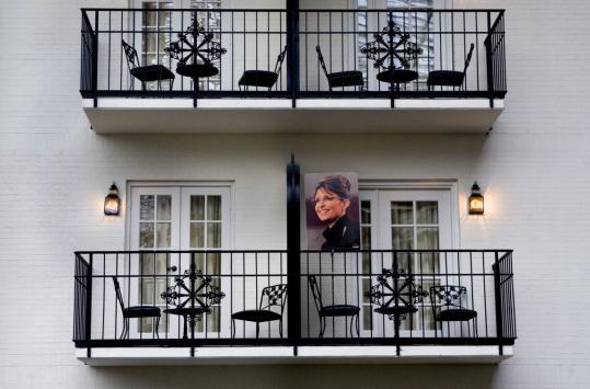 Sarah Palin will address the National Tea Party Convention in Nashville today. A poster adorned a balcony yesterday in the city. Her growing support system could be after any number of goals.
