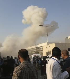 A cloud of smoke rose outside Karachi's Jinnah Hospital after a second bomb blast within hours killed 13 people yesterday. Earlier, a motorbike rigged with explosives killed 12.