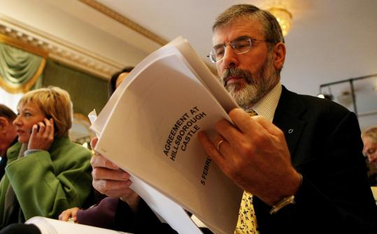 Gerry Adams, Sinn Fein's president, read a copy of the agreement reached to save Northern Ireland's Catholic-Protestant power-sharing government yesterday.