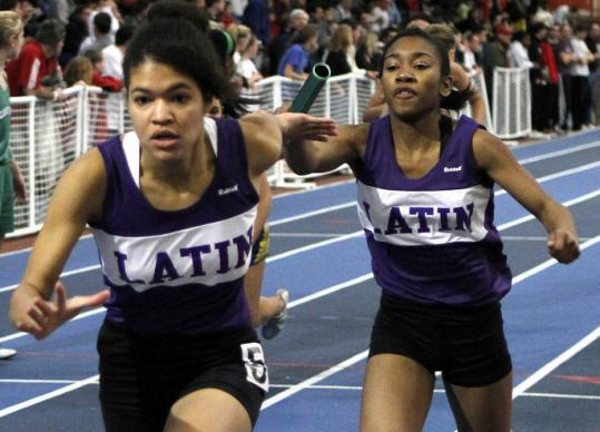 Meisha Brooks takes the baton from Tamika Reid and went to complete Boston Latin's state record-setting run.