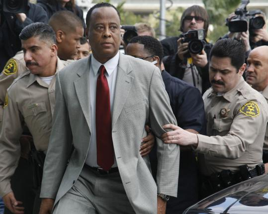 "Before entering the courtroom yesterday in Los Angeles, Dr. Conrad Murray, who was Michael Jackson's physician, walked past hundreds of the singer's fans, many of whom shouted ""murderer.'' Murray faces up to four years in prison if convicted."