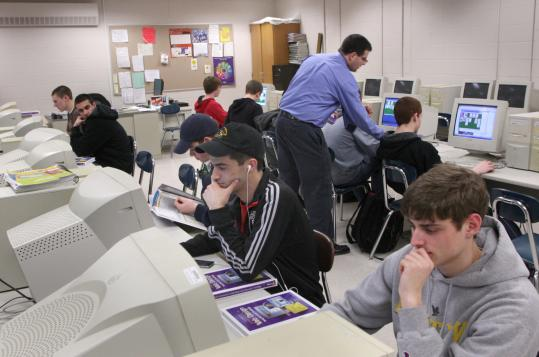Students work in a website design and publishing class at Holliston High, where administrators want to provide a computer for every student.