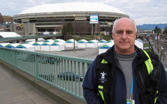 Ron Cameron in front of BC Place, site of the ceremonies in Vancouver, British Columbia.