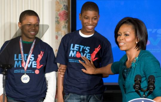 "Michelle Obama, appearing with members of the Watkins Hornets, the 2009 National Championship Pee-Wee football team, spoke yesterday at the White House about her initiative, ""Let's Move,'' a campaign to help combat childhood obesity."