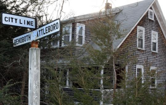 """The boundary is very clear,'' Stanley Nacewicz, city assessor, said of John Harker's property. ""That house is on Reynolds in Attleboro.'' Harker paid taxes to both Attleboro and Rehoboth."