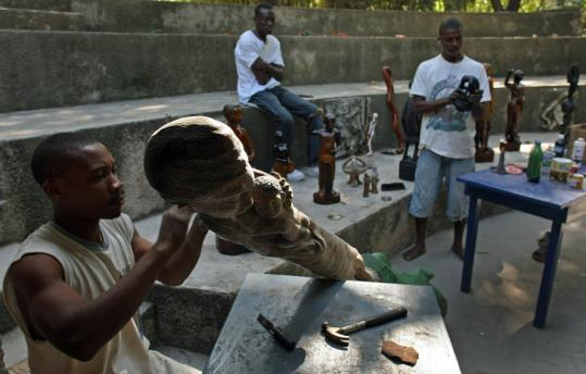Rodrigue Bienaime worked on an idol at a sanctuary in Mariani, Haiti, last week. More than half Haiti's population is believed to practice voodoo.