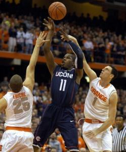 Syracuse's Andy Rautins and Brandon Triche try to get a hand on Jerome Dyson's shot during the first half.