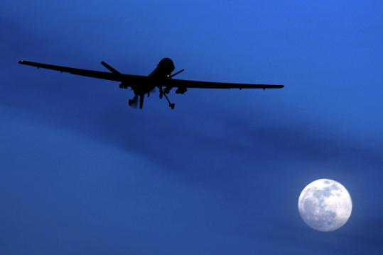 A US Predator drone flies over the moon above southern Afghanistan in January.